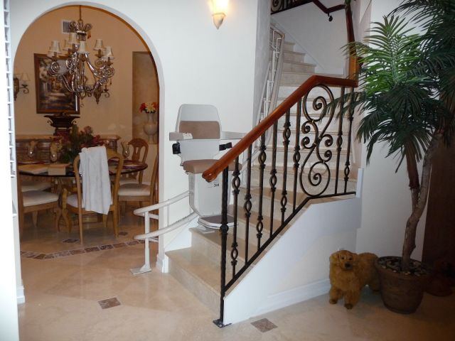 Curving stairlift on a marble staircase