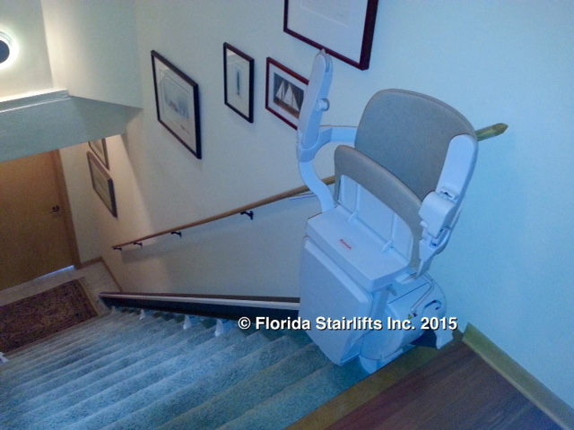 Stannah 600 stairlift folded close to the wall